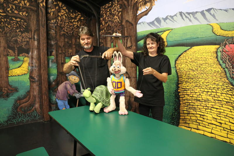 Puppeteers John and Karri Scollon demonstrate bringing two marionettes to life.