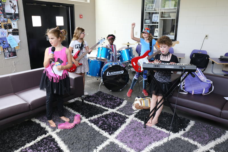 The Legendary Tigers, a band of 8 and 9 year olds, practice their original song at the dance studio in Columbia College.