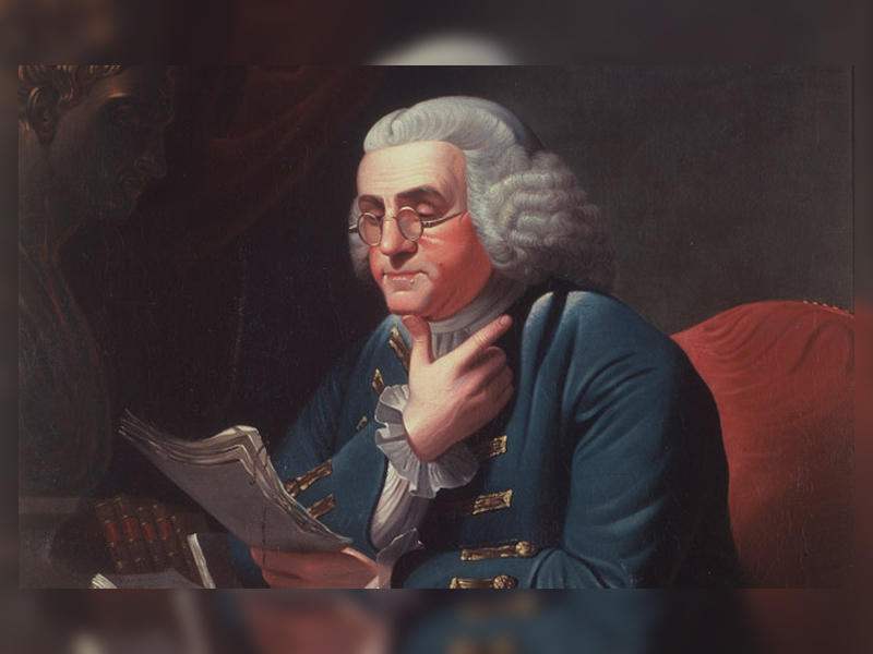 Benjamin Franklin seated, reading a manuscript which he holds in his left hand. Benjamin Franklin by David Rent Etter, after Charles Willson Peale, after David Martin (1835)