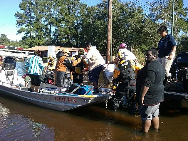 Residents in Nichols, SC are rescued by boat after Hurricane Matthew in 2016