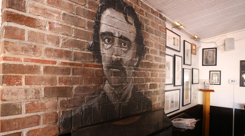 Edgar Allan Poe mural above the fireplace, Poe's Tavern Sullivan's Island, SC.