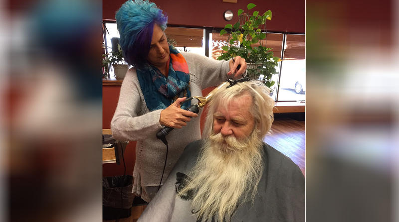 "Beautician Carol Ann Porter works on her favorite client, ""Santa Cotton."""