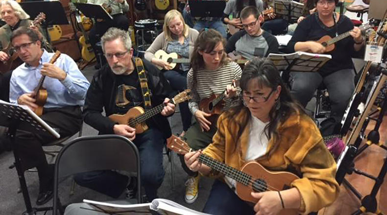 Cola Ukulele Band rehearses for an upcoming performance.