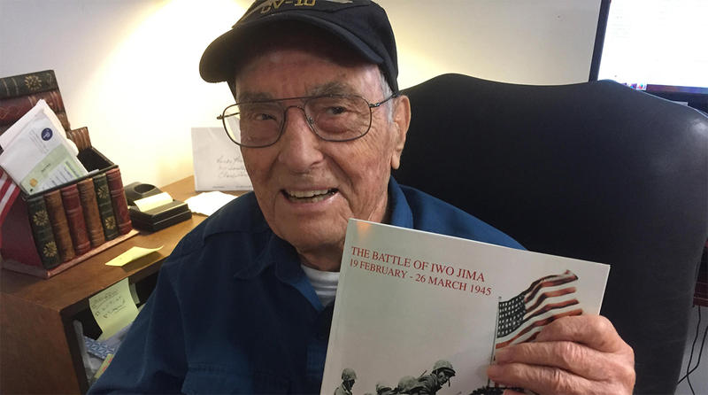 World War II veteran Marvin Veronee of Charleston with a photo book, for which he wrote the text, on the Battle of Iwo Jima.  Veronee was in the battle as a 19-year-old sailor.