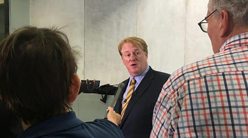 Former Rep. Rick Quinn talking with news reporters at the Richland County Courthouse in Columbia, after his indictment in May, 2017.