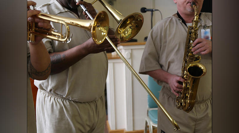 The horn section of the band at Lee Correctional Institution.  Musicians work on original songs to perform with members of DeCoda, a New York-based chamber music group.   The annual week of collaboration is something new for everyone involved.