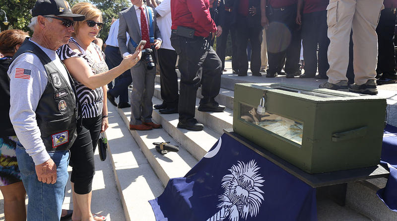 James and Tammy Blackwell take a picture of a box containing the names of all South Carolinians who died during the Vietnam War.