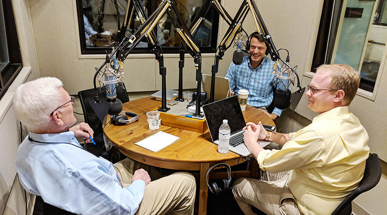 Gavin Jackson (c) speaks with Russ McKinney (l) and Jamie Lovegrove in the South Carolina Public Radio studios on Monday, May 7, 2018.