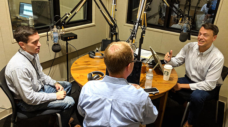 Gavin Jackson (r) speaks with Andy Brown (l) and Jamie Lovegrove in the South Carolina Public Radio studios on Monday, May 14, 2018.