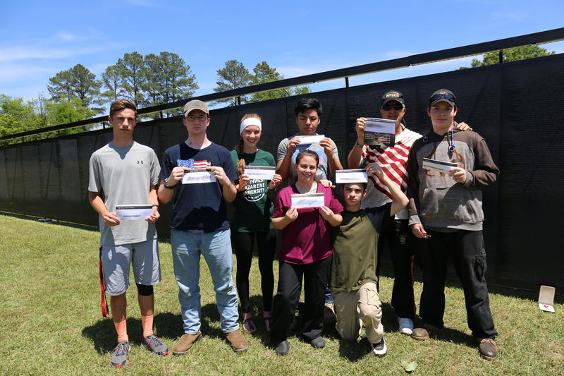 Camden High School students display their name rubbings from replica wall