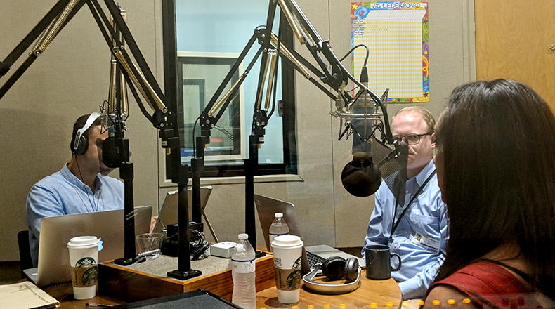 Gavin Jackson (l) speaks with Jamie Lovegrove and Meg Kinnard (r) in the South Carolina Public Radio studios on Wednesday, June 13, 2018.