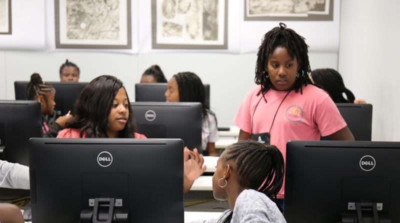 Instructor Jaya Gantt, a recent graduate of USC, teaches 6th-grader Kenney Williams and other students at Girls Go for I.T. camp.