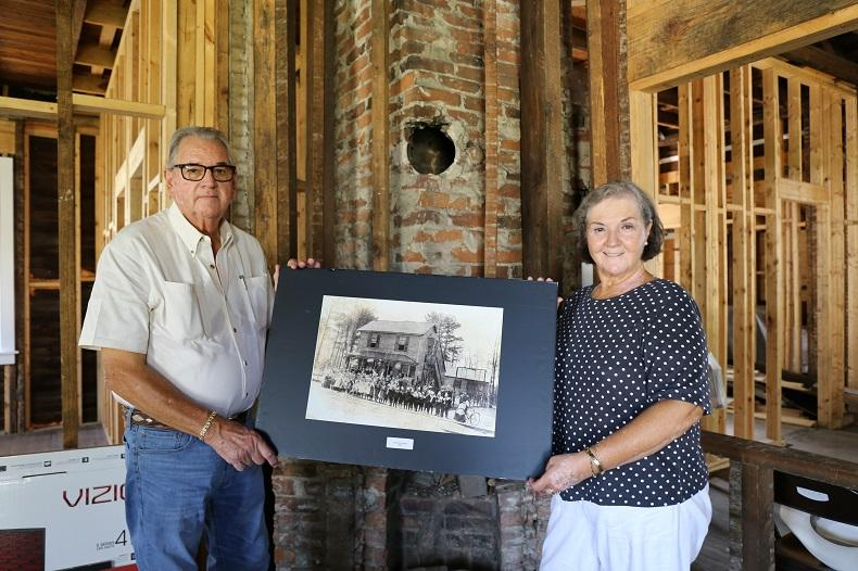 A four-year journey: Jake and Sherry Jaco inside the Olympia Mill school during the construction phase of the museum