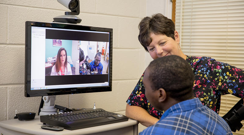 Nurse practitioner Kelli Garber consults with a patient through telehealth at C.E. Murray High School in Williamsburg County.