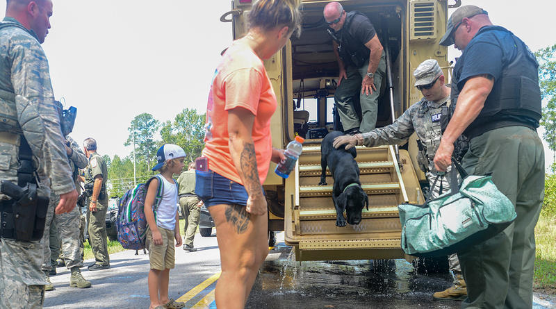 U.S. Air Force Security Forces Airmen assigned to the South Carolina Air National Guard, 169th Fighter Wing, assist Florence County, S.C., Sheriff's Department with evacuation efforts in Florence, S.C., Sept. 17, 2018.