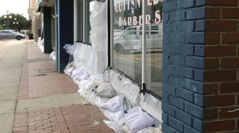 Georgetown businessees use sand bags to protect property along the river front