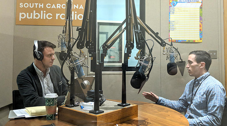 Gavin Jackson (l) speaks with Andy Brown in the South Carolina Public Radio studios on Monday, December 3, 2018.