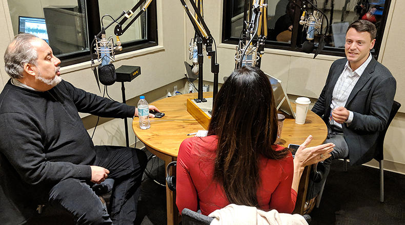 Gavin Jackson (r) speaks with Andy Shain (l) and Meg Kinnard in the South Carolina Public Radio studios on Monday, January 14, 2019.