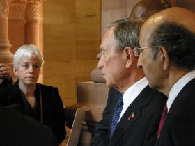 Karen at a Mike Bloomberg press conference in Albany.