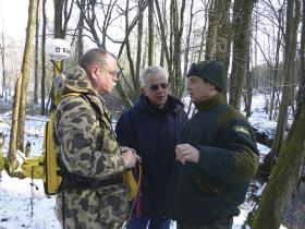 MTSU's Dr. Tom Nolan, left, and Châtel-Chéhéry Mayor Roland Destaney listen to Damien Georges, a regional forester with France's forest service, describe the World War 1 battlefield area where Nolan and his team were preparing to map artifacts in March 2006. (file photo courtesy of Dr. Tom Nolan)