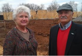 Andrea Lawrence (L) President of Tennessee Fisher House and TFH Board Member Colonel (Retired) Thomas Vaughn (R) stand in front of Tennessee's first Fisher House under construction on the grounds of the VA Hospital in Murfreesboro, Tenn., in December, 2012.