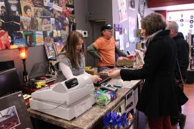 Little Shop of Records owners Sandi and Grant Polston assist customers in their recently opened store.