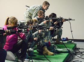 Vistors try out the new indoor ROTC firing range simulator on the MTSU campus in early February.