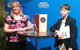 Jonathan Caldwell of Hendersonville, Tenn., right, winner of the Middle Tennessee 2013 Regional Spelling Bee at MTSU, is joined by his mother, Holly Caldwell, for publicity photos after his 18th-round win March 20. Caldwell is a seventh-grader at Merrol Hyde Magnet School. (MTSU photo by News and Media Relations)