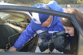 MTSU professor Cliff Ricketts, left, explains the hydrogen fueling process to a Savannah, Ga., television reporter. A 2005 Toyota Prius and a 1994 Toyota Tercel use hydrogen from water separated by sun (solar), all produced on the MTSU campus, as the fuel sources.