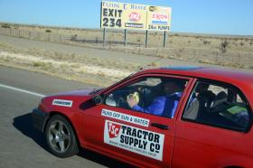 Dr. Cliff Ricketts at the wheel of a hydrogen burning Toyota sedan somewhere in New Mexico during his 2600 mile, coast-to-coast, alternative fuel experimental drive.