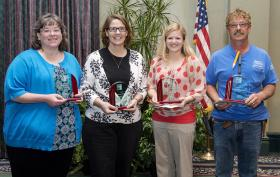 Employees of the Year, from left to right, Classified Employee of the Year Barbara Money, Secretarial/Clerical Employee of the Year Peggy Slater, Administrative Employee of the Year Jamie Brewer and Technical/Service Employee of the Year Forrest Higginbotham