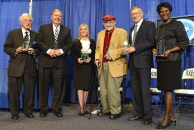 The first members of the Tennessee Journalism Hall of Fame gather for a photo after an April 26 ceremony in MTSU's Murphy Center celebrating their accomplishments. From left are inductees John Seigethaler, Chris Clark, Karen Miller representing her late husband Dan Miller, Dean Stone, Bill Williams Jr. and Anne Holt. The new Hall of Fame will be housed in the Center for Innovation in Media inside the Bragg Mass Communication Building at MTSU. (MTSU photo by Andy Heidt)
