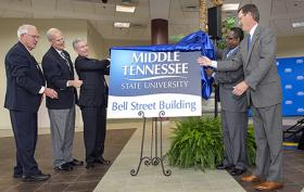 MTSU President Sidney A. McPhee, second from right, is joined by hospital and community dignitaries today to unveil signage for the university's new Bell Street Building, formerly part of the former MTMC property. With McPhee are, from left, Rutherford County Mayor Ernest Burgess; Dr. Lee Moss, chairman of the MTMC board of directors; MTMC President and CEO Gordon Ferguson; and Murfreesboro Mayor Tommy Bragg.