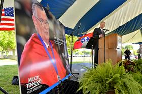 Jeff Whorley glances at a photo of his late uncle, Nobel laureate and MTSU alumnus James M. Buchanan, during a celebration Thursday afternoon of Dr. Buchanan's life outside the Paul W. Martin Sr. Honors Building.