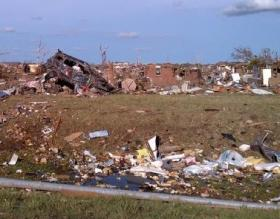 Moore, Okla., May 21, 2013 -- The remains of homes destroyed when a deadly tornado struck May 20, 2013.