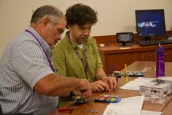 Teachers from Marshall, Robertson and Davidson counties work to build a doodler robot, June, 2013.