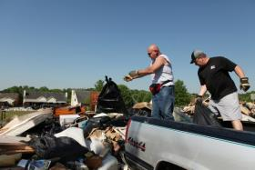 Volunteers clear debris left behind by Tennessee's record setting 2010 floods.