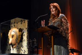TPAC president and chief executive officer Kathleen O'Brien unveils a handcrafted replica of the lioness mask from Disney's The Lion King at the performing arts center's annual gala.