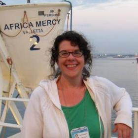 Pamela Campbell poses by one of the lifeboats onboard the Africa Mercy, the world's largest private hospital ship, currently docked in Pointe Noire, Congo, Africa.