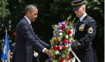 President Barack Obama participates in a Memorial Day wreath laying at the Tomb of the Unknowns at Arlington National Cemetery in Arlington, Va., May 27, 2013.