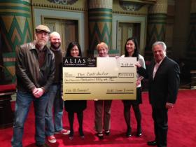 "Alias Chamber Ensemble presents check to the ""Contributor"""