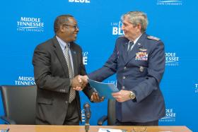 With a handshake, MTSU President Sidney A. McPhee, left, seals the Memorandum of Agreement with Civil Air Patrol Tennessee Wing commander Col. Bill Lane. The signing between MTSU and the CAP forms a partnership in aerospace education for state high school students in the U.S. Air Force auxiliary's cadet program. (MTSU photo by J. Intintoli)