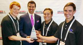 """Three members of MTSU's EMC Productions student TV production team accept the top national collegiate honor Wednesday for """"Outstanding Live Game and Event Production"""" at the 2014 College Sports Media Awards in Atlanta. From left are senior Chris Robertson of La Vergne, Tennessee, director of EMC Productions; ESPN's Rece Davis, who served as host for the awards event; senior Justin Beasley of Humboldt, Tennessee; and junior Joshua Cragg of Murfreesboro. (Photo courtesy of Mike Forbes)"""