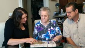 Linda and Ron Cathey look through family photo albums with Linda's mother, Mary Jane Worthwell, in the dining room of their Murfreesboro home, June, 2014.