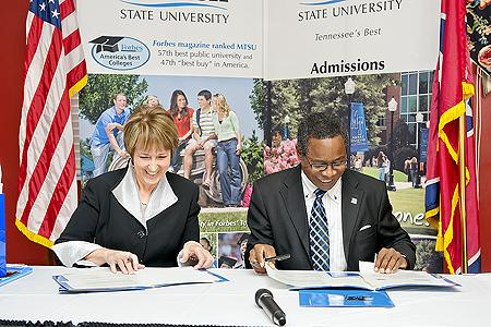 Dr. Mary Lou Apple, left, president of Motlow State Community College, and MTSU President Sidney A. McPhee look over the paperwork for a new Dual Admission Program during a signing ceremony Nov. 2 in MTSU's James Union Building.