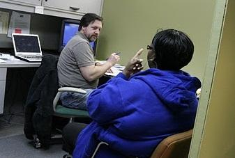 The Journey Home's Scott Foster works with a homeless client at the agency's offices in downtown Murfreesboro.