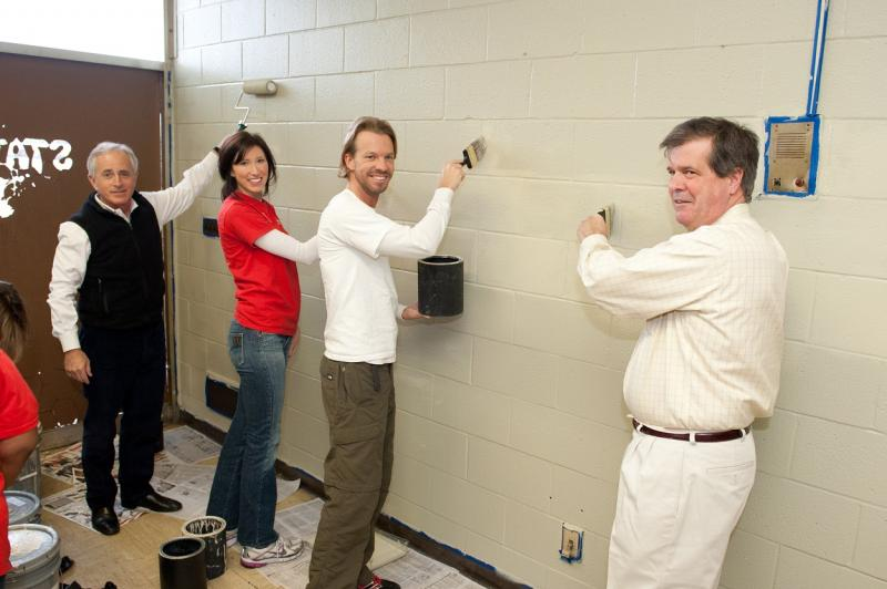 (Left to Right) U.S. Sen. Bob Corker; Corinne C. Bergeron, Jackson National Life Insurance Company; Brian Williams, Hands On Nashville; and Mayor Karl Dean join volunteers in painting Nashville Fire Department