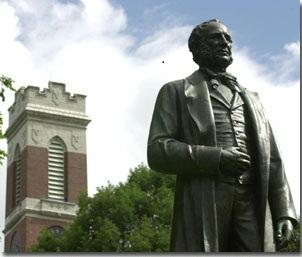 A statue of Commodore Cornelius Vanderbilt in front of Kirkland Hall on the VU campus.