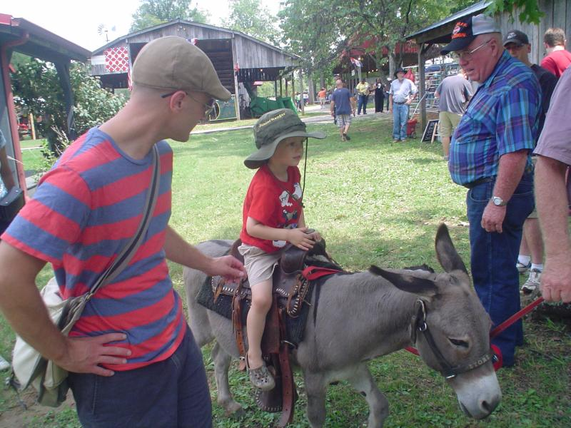 Reporter Shawn Anfinson (left) and his son enjoying the Wilson County Fair
