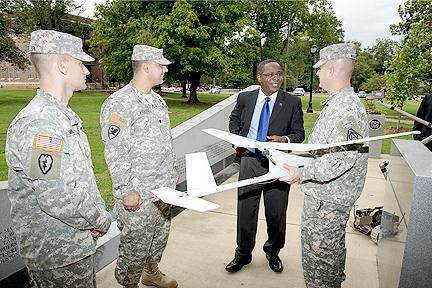 MTSU President Sidney A. McPhee, center right, chats with Lt. Cols. Joel Miller, left, Nick Kioutas and Robb Walker after an Aug. 13 signing ceremony of a partnership agreement between the U.S. Army and MTSU involving unmanned vehicles.